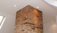 Exposed brick chimney